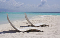 Sun bed on sandy beach Stock Photos