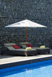 Sun bed in Swimming pool area Stock Photography