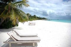 Sun beds. On the sandy beach of Maldives Royalty Free Stock Photos