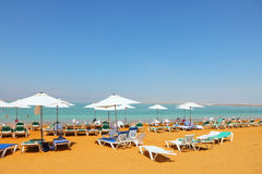 Sun beds, chairs, umbrellas. And awnings on the beach luxury hotel on the Dead Sea in Israel. Sunny spring day Royalty Free Stock Image