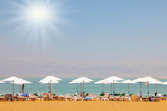 Sun beds  on the Dead Sea. Sun beds, chairs, umbrellas and awnings on the beach luxury hotel on the Dead Sea in Israel. Sunny spring day Royalty Free Stock Photo