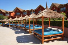 Sun Beds in Holiday Resort. Typical Sun Beds in a Holiday Resort Royalty Free Stock Image