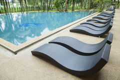Sun beds near a swimming pool. In thailand Royalty Free Stock Photo