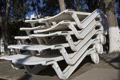 Sun beds off season stockpiled. Stock Image