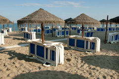 Sun beds and Parasols. On a beach in Spain Stock Image