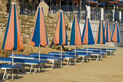 Sun-beds and parasols Stock Images
