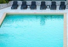 Sun beds. Sun beds near the pool Royalty Free Stock Photos