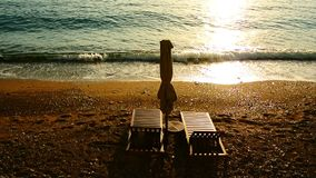 Sun beds and umbrellas on the beach. Montenegrin beaches of the. Adriatic Sea. Sveti Stefan beach stock video