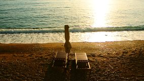 Sun beds and umbrellas on the beach. Montenegrin beaches of the stock video footage