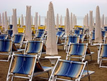 Sun beds and umbrellas closed Stock Images