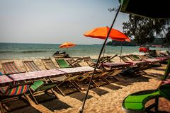 Sun beds and umbrellas on ochheutal beach. Cambodia stock photography