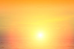 The sun began to rise from the sea in the morning. Stock Photography