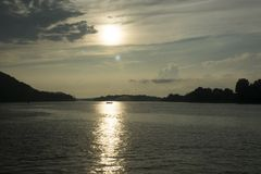 Sunset on the Ohio River. The sun begins to set on the Ohio river at Parkersburg West Virginia with Blennerhassett Island in the distance down river royalty free stock photography