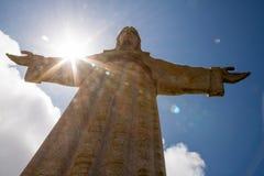 Sun behind Christus Rei Statue in Lisbon, Portugal. Europe stock photography