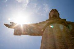 Sun behind Christus Rei Statue in Lisbon, Portugal. Europe royalty free stock photo