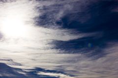 Sun behind cirrus clouds stock photography