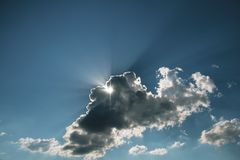 The sun behind a cloud royalty free stock photo