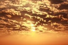 Sun behind cloud orange warm sky. Dramatic Sun behind cloud orange warm sky Royalty Free Stock Photo
