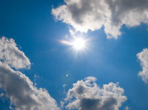 Sun behind clouds Stock Photos