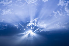 Sun behind clouds Royalty Free Stock Image