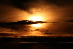 The Sun behind clouds Royalty Free Stock Images