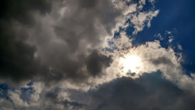 Sun behind clouds background Stock Photography