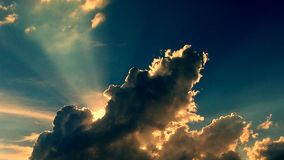 Sun behind clouds stock images