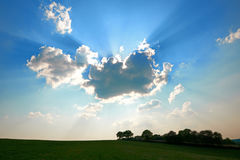 Sun behind Clouds. With Landscape silhouette Stock Photos