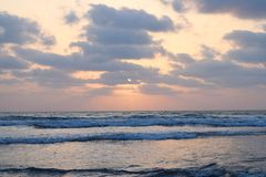 Sun behind Clouds over Infinite Ocean - Natural Sunset Wallpaper Stock Images