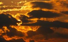 Sun behind dark cloud Royalty Free Stock Photo