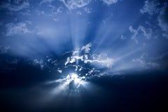 Sun behind dark clouds Royalty Free Stock Photos