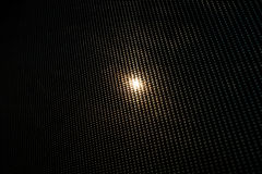 Sun behind dark curtain Royalty Free Stock Image