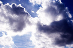 Sun behind the gray clouds in sky Royalty Free Stock Photos