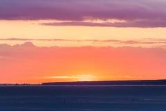 Sun behind the horizon Royalty Free Stock Photo