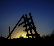 Sun behind a metal fence Stock Photo