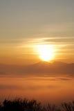 Sun behind the mountain Royalty Free Stock Photo