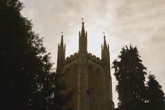 Sun Behind Old English Church Tower. Shallow Depth of Field Autumn Split Toning Photography Royalty Free Stock Images