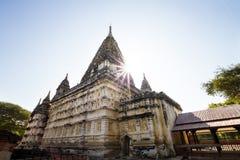 Sun behind a temple in Bagan, Myanmar Stock Image