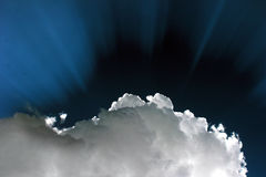 Sun behind the white cloud. Dramatic blue sky with sun rays Royalty Free Stock Photos
