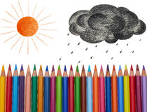 Sun and black cloud. Painted sun and black cloud over pencil fence Stock Photo