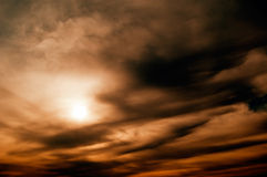The sun and black clouds. Stock Photo