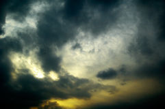 The sun and black clouds. The sun on background black clouds Royalty Free Stock Photos