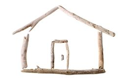 Bleached drift wood house. Sun bleached drift wood in shape of a house isolated on white background Royalty Free Stock Images