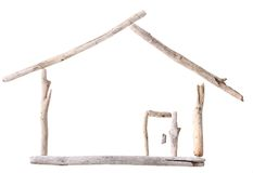 Stick house. Sun bleached drift wood in shape of a house isolated on white background Stock Image