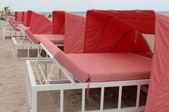 Sun bleached lounge chairs on the beach Stock Photos