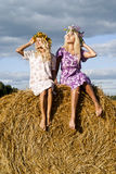 Sun blinding blondy girls. Sun blinding two blondy girls Royalty Free Stock Images