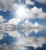 Sun,blue sea and white clouds reflection Stock Photos