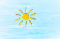 Sun on blue sku made from plasticine Stock Photos