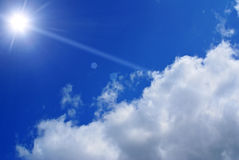 Sun in blue sky. Sun and clouds against blue sky Stock Photo