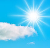 Sun in blue sky. Sun in the blue sky and a lonely cloud Stock Image